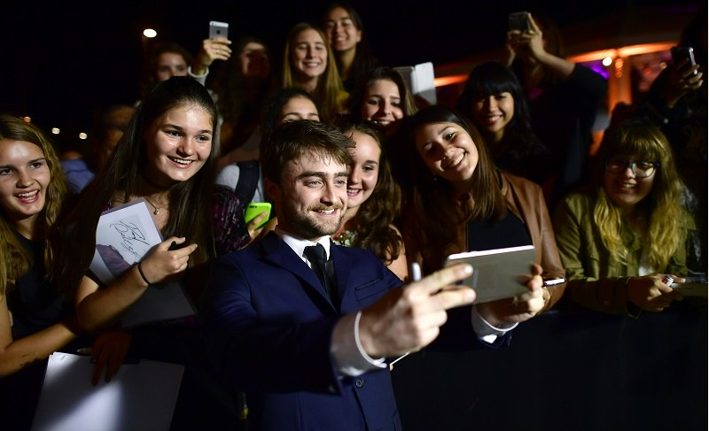 At the Zurich Film Festival, Daniel Radcliffe enjoys a moment with fans.