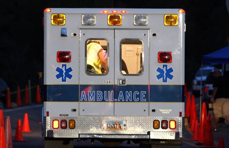 An ambulance is seen driving off