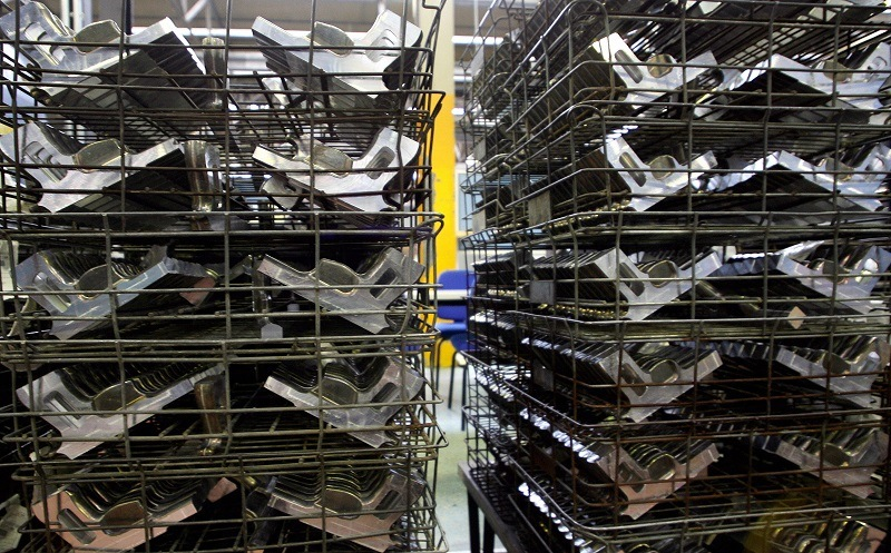 Parts of Beretta 92S semi-automatic pistol series stored before the final touches at the Beretta manufacturing company