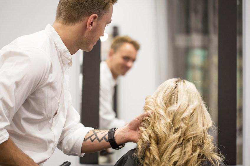 hairdresser curling woman's hair
