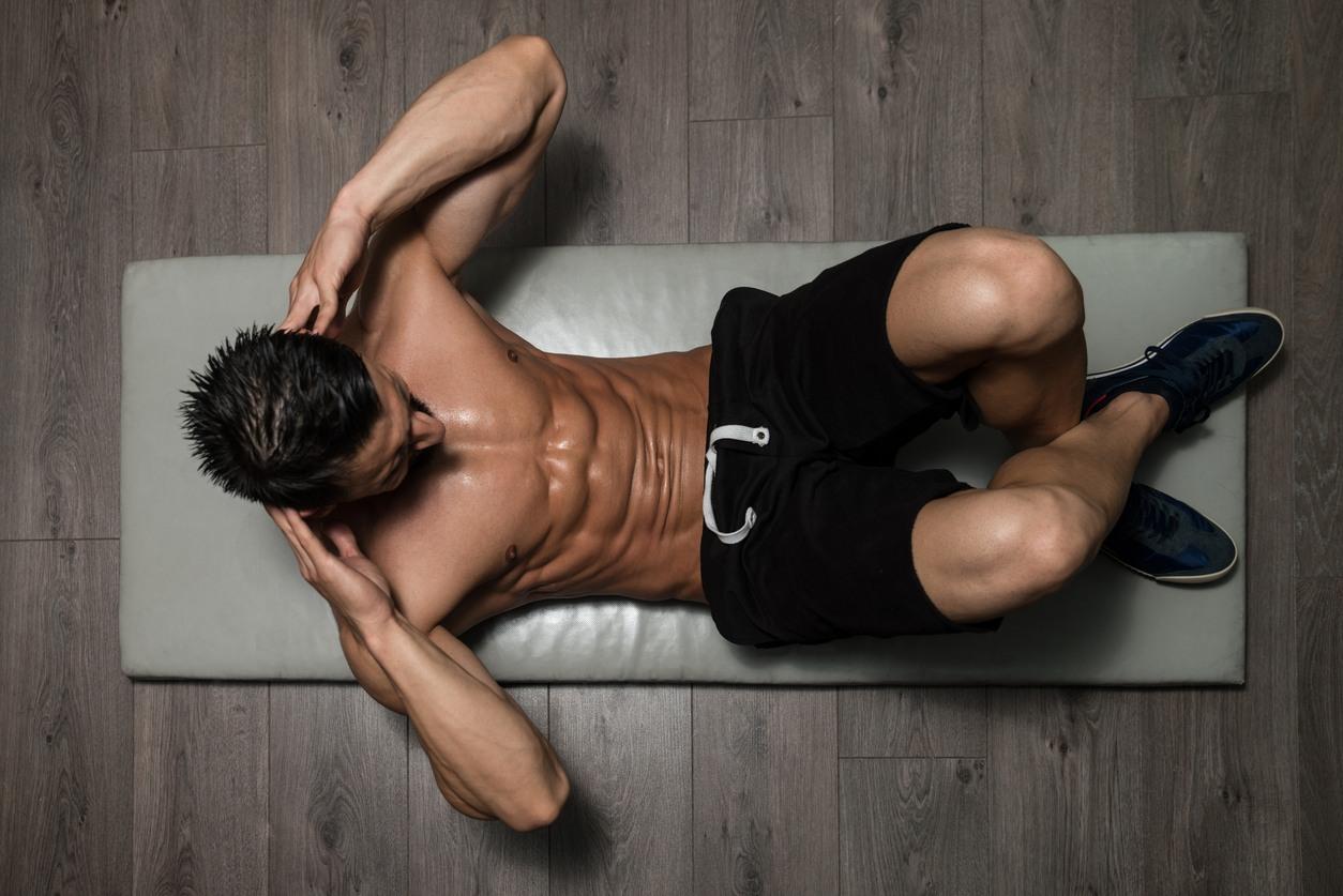 Man exercises his abdominals