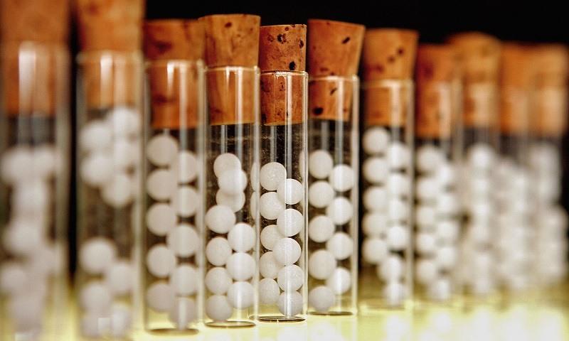 Vials containing white pills