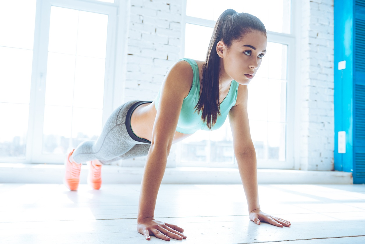 Woman practices burpees