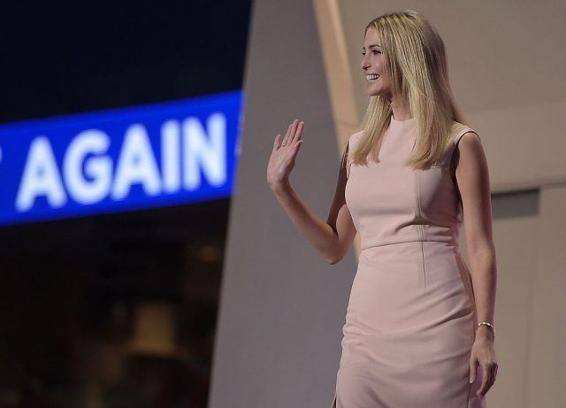 Ivanka Trump smiling and waving on stage.