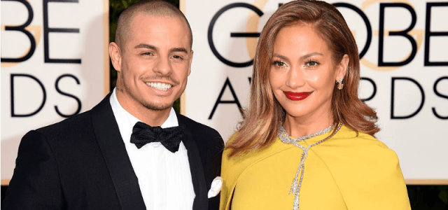 Jennifer Lopez and Casper Smart posing for photos on the red carpet of the Golden Globes.