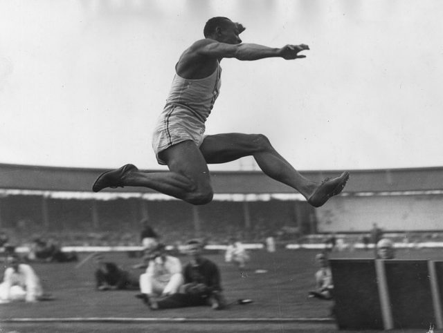 American athlete, Jesse Owens takes part in the long jump event in a USA versus British Empire