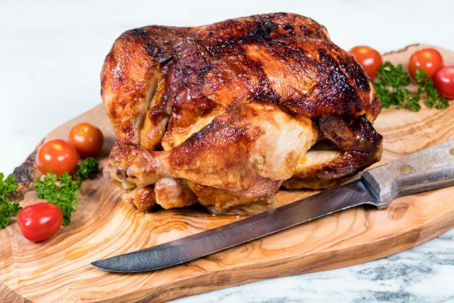 Barbecued chicken with vegetables ready to be sliced
