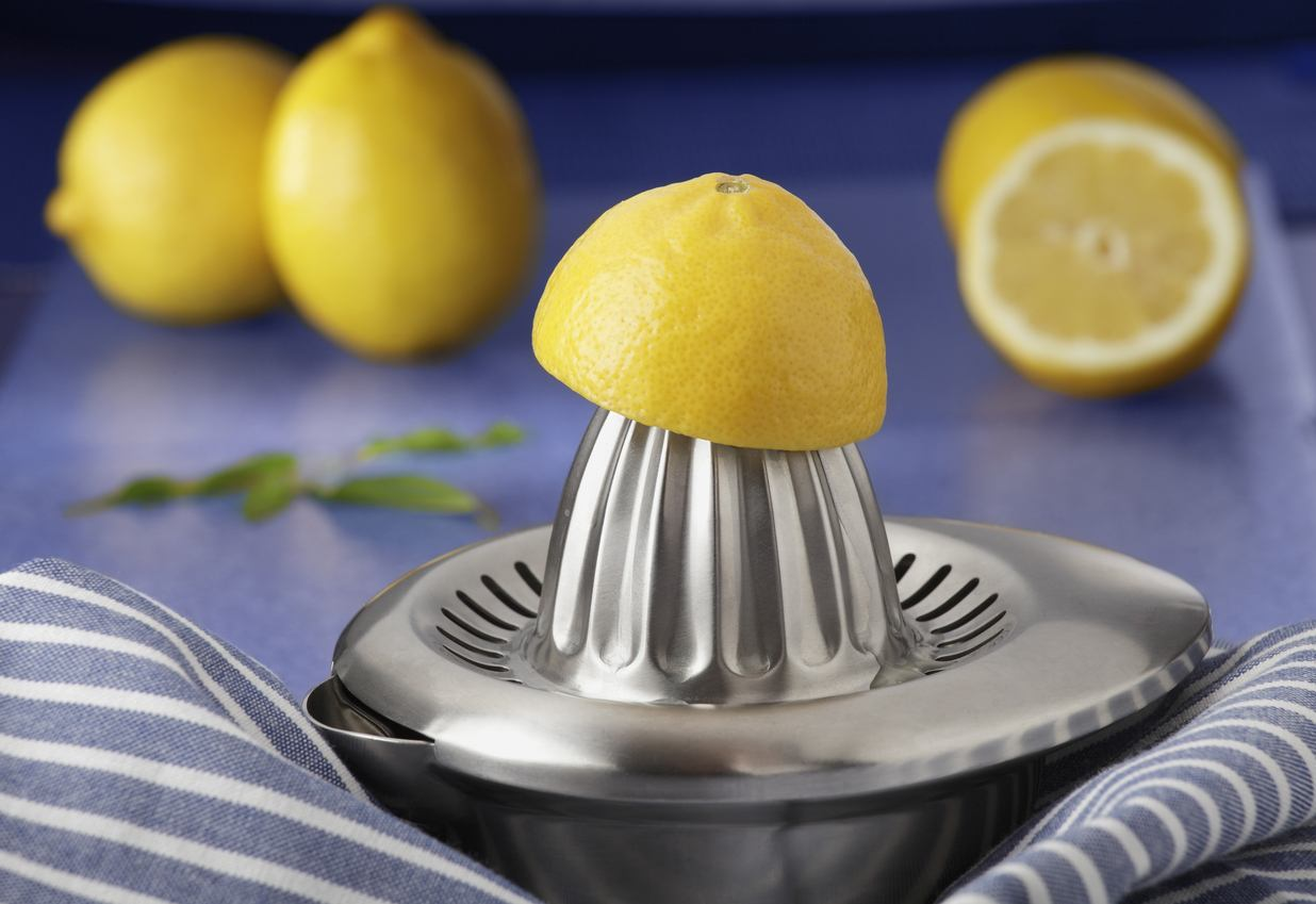 lemon on steel lemon juicer