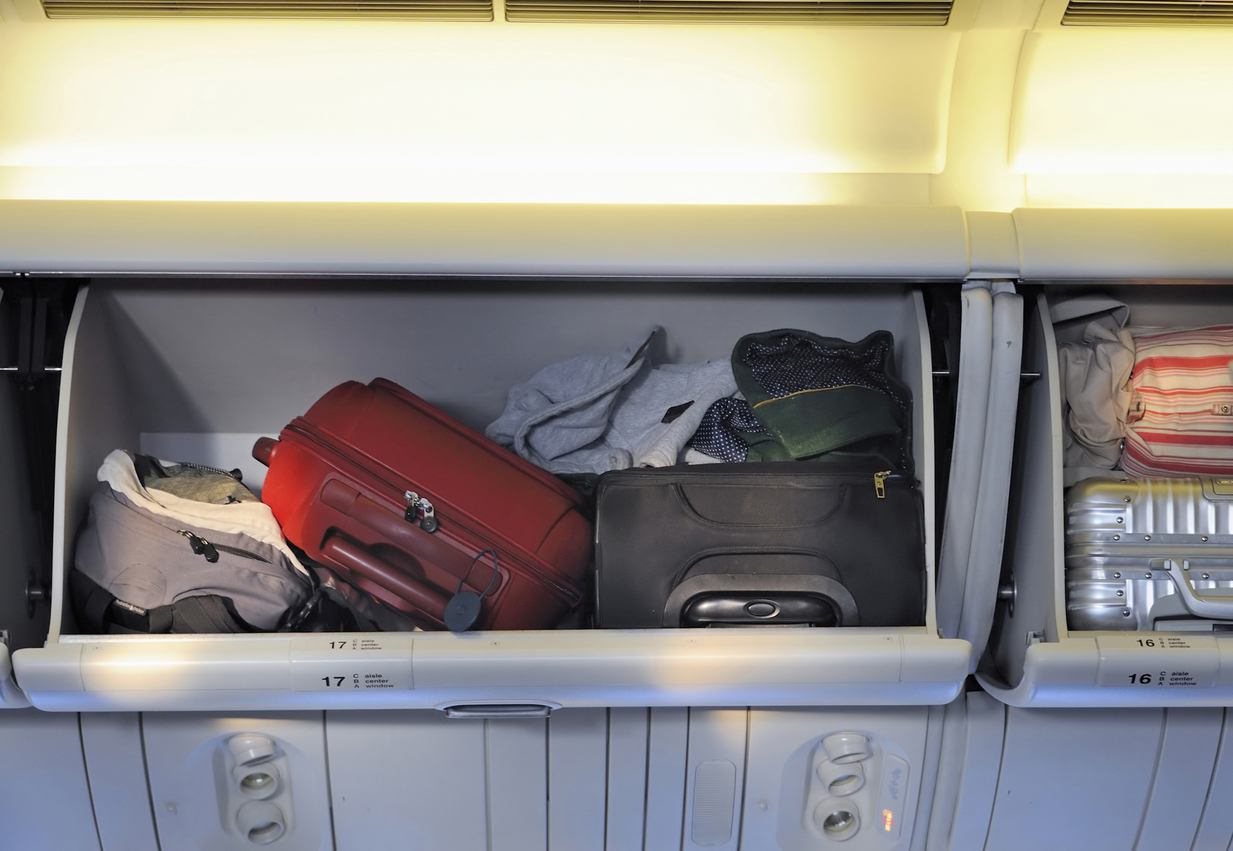 Carry-on luggage in overhead storage compartment