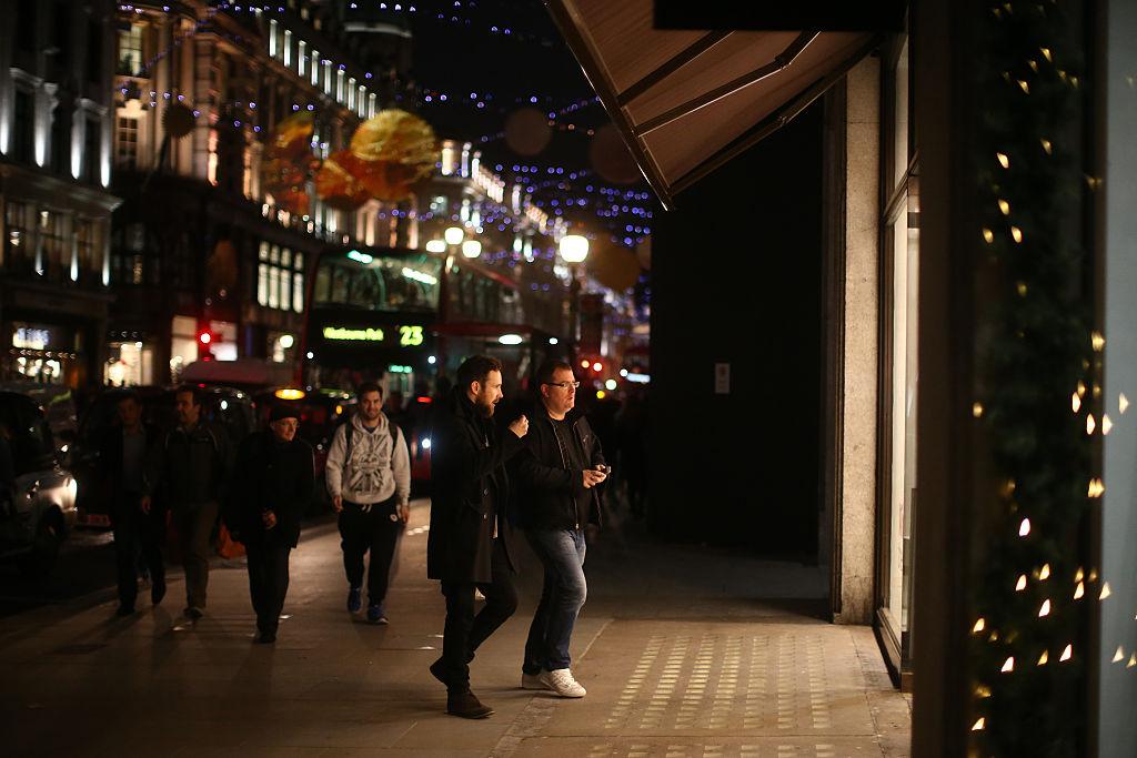 Men enter a luxury goods shop