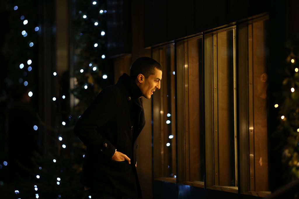 A man looks into the window of an antique jewellery shop