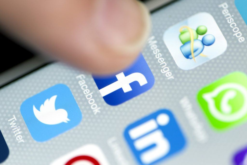 Apple iPhone 6 screen with social media applications