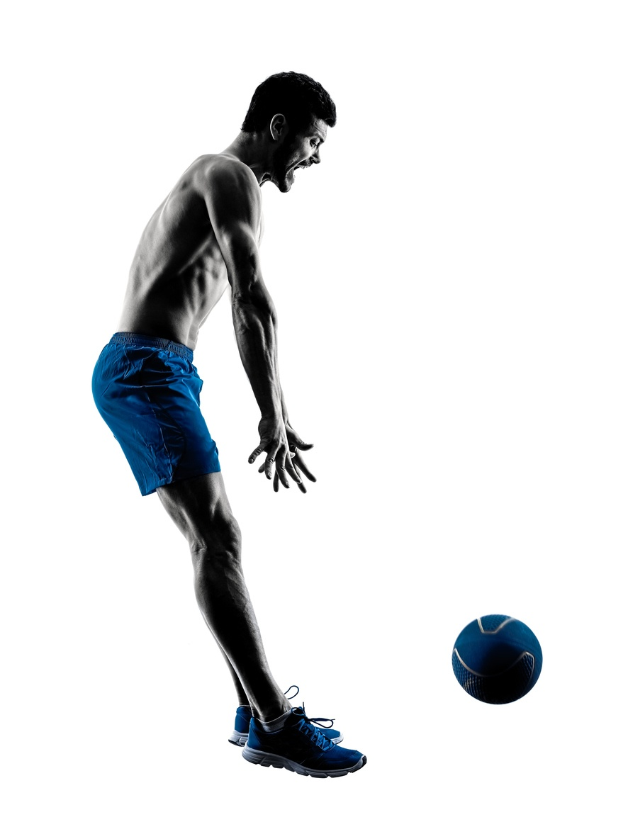 A man throws a medicine ball