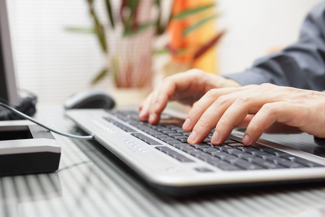 man is typing on keyboard