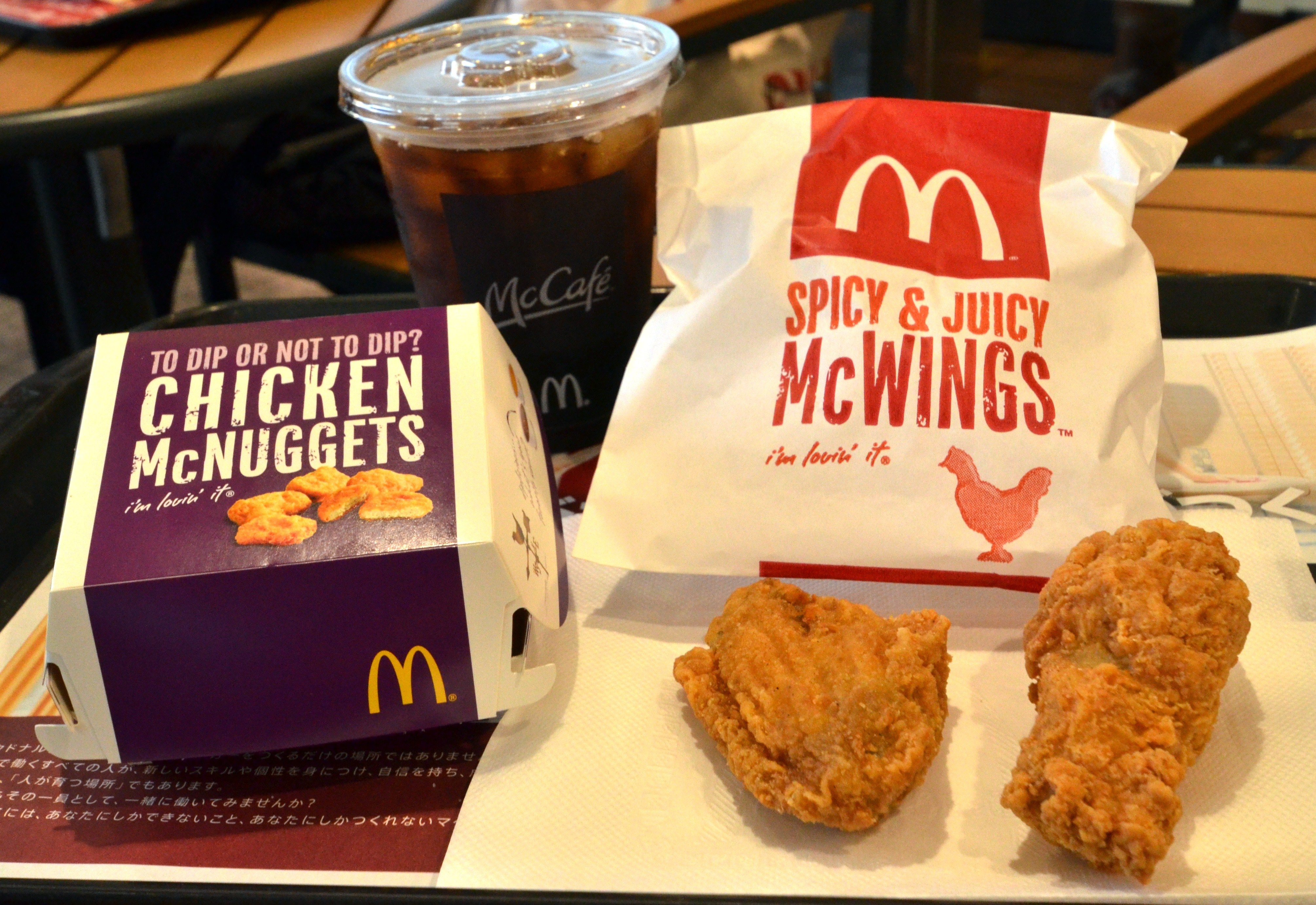 Chicken McNuggets (L) and McWings are displayed at a McDonald's restaurant