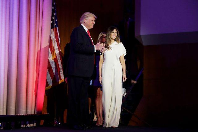 Donald and Melania walking onstage.