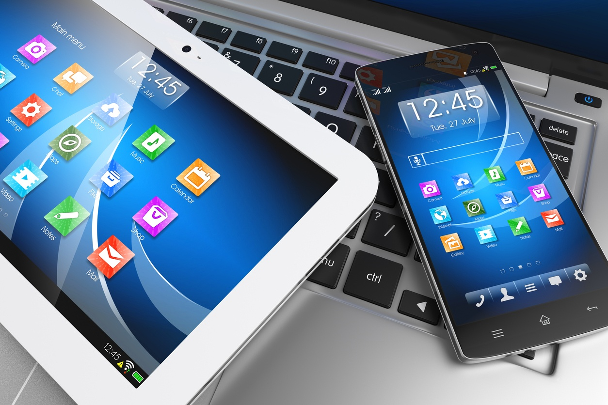 Mobile devices. Tablet PC, smartphone on laptop