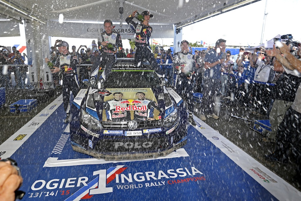 Miikka Anttila (FIN), Julien Ingrassia (F), Sebastien Ogier (F), Jari-Matti Latvala (FIN) celebrate during the FIA World Rally Championship 2015 | Volkswagen Motorsport/Red Bull Content Pool
