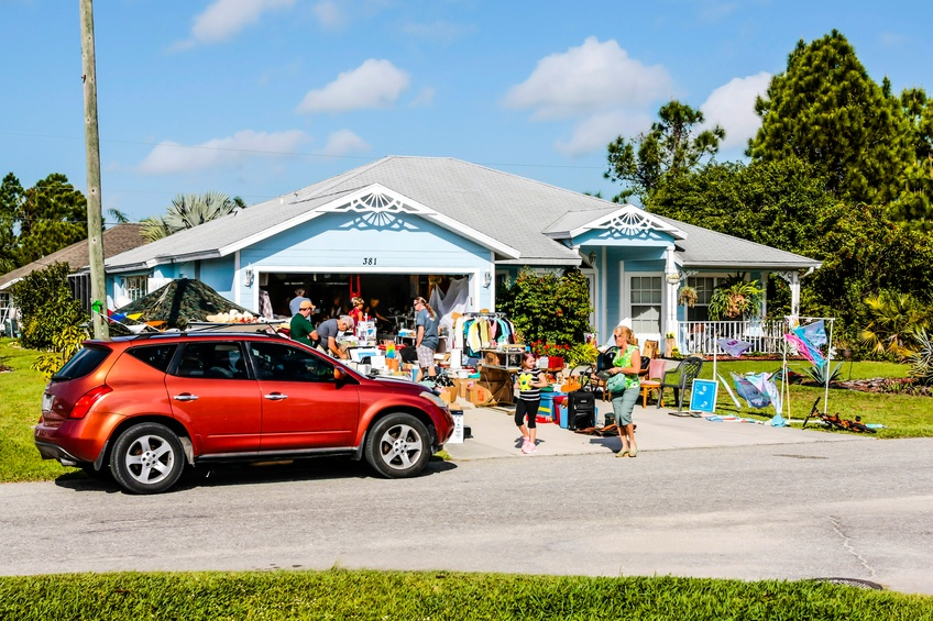 People visiting a yard sale at a home