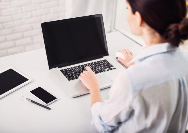 Woman working in the office on her laptop