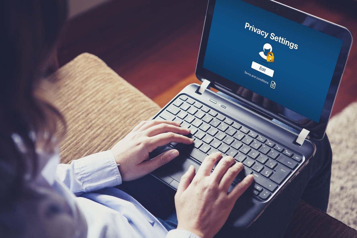Woman using Privacy Settings on laptop