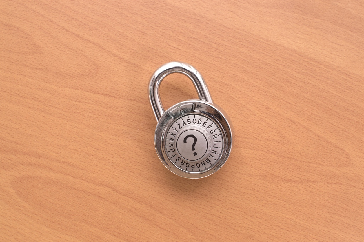 Question Mark Combination Lock on wooden background