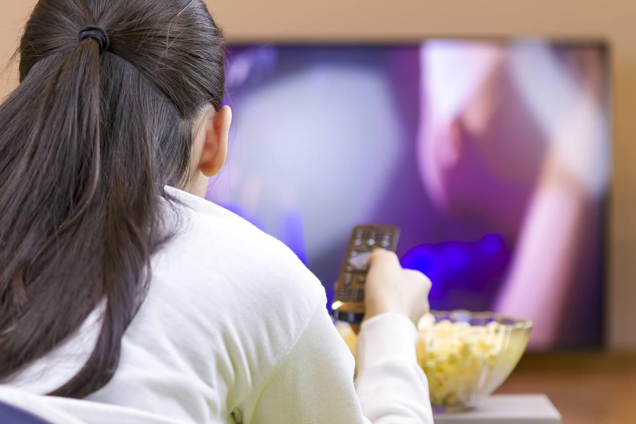 A woman watching TV
