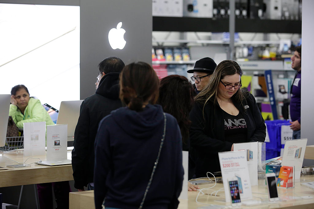 Customers shop for electronics and other items at a Best Buy