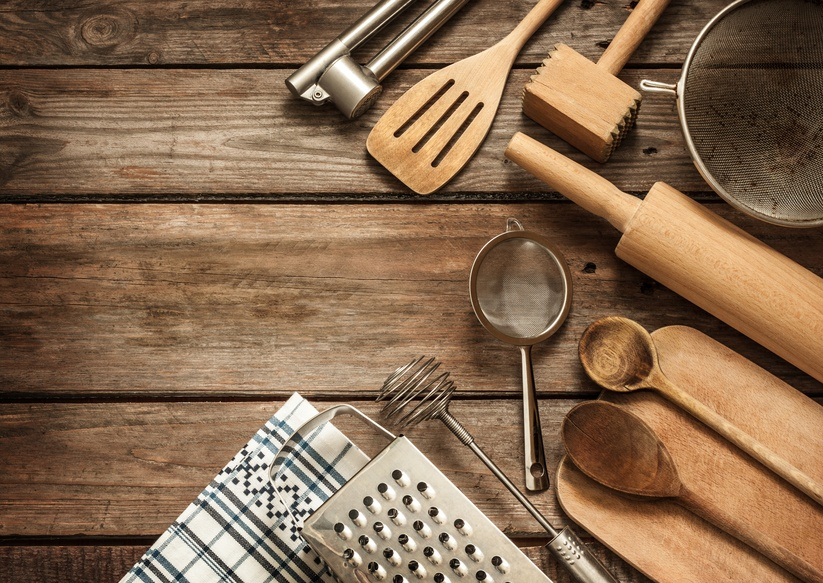kitchen utensils on vintage planked wood