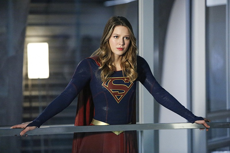 Melissa Benoist's Kara/Supergirl stands behind a desk in Supergirl Season 2