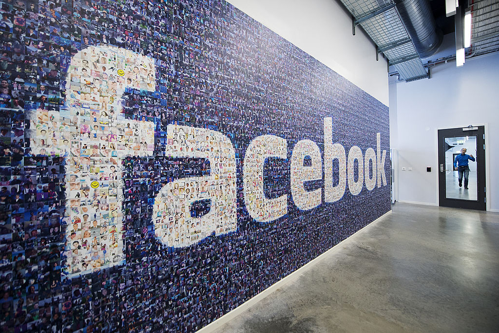 A big logo created from pictures of Facebook users worldwide is pictured in the company's Data Center
