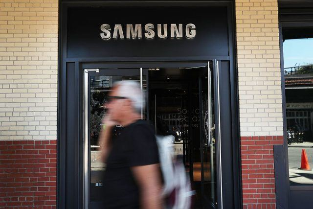 People walk by the new Samsung store in lower Manhattan