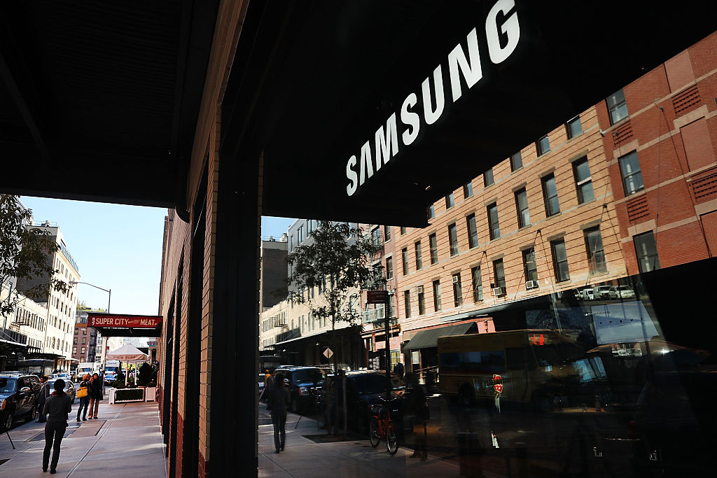 People walk by the new Samsung store in lower Manhattan on October 11, 2016 in New York City