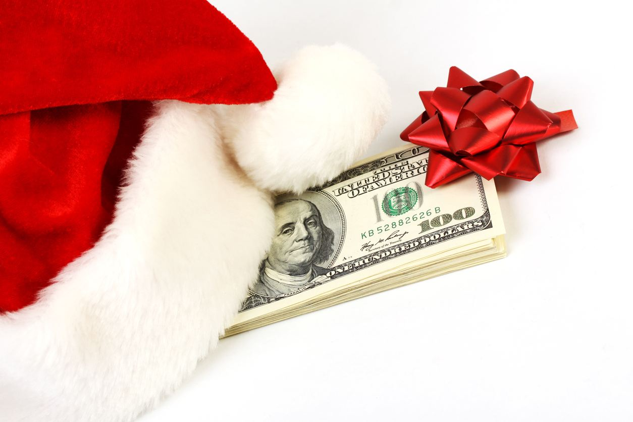 stack of money with a bow on it for holiday tipping