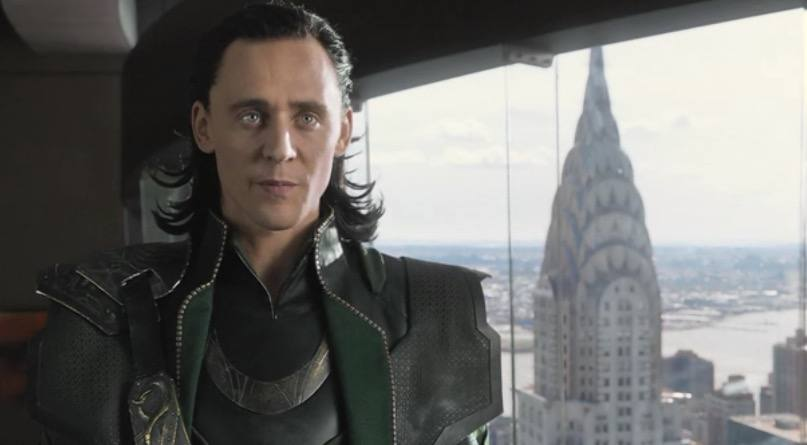 Loki looking straight ahead, with New York City in the background