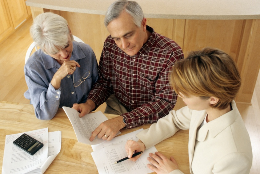 couple talking to financial planner at home
