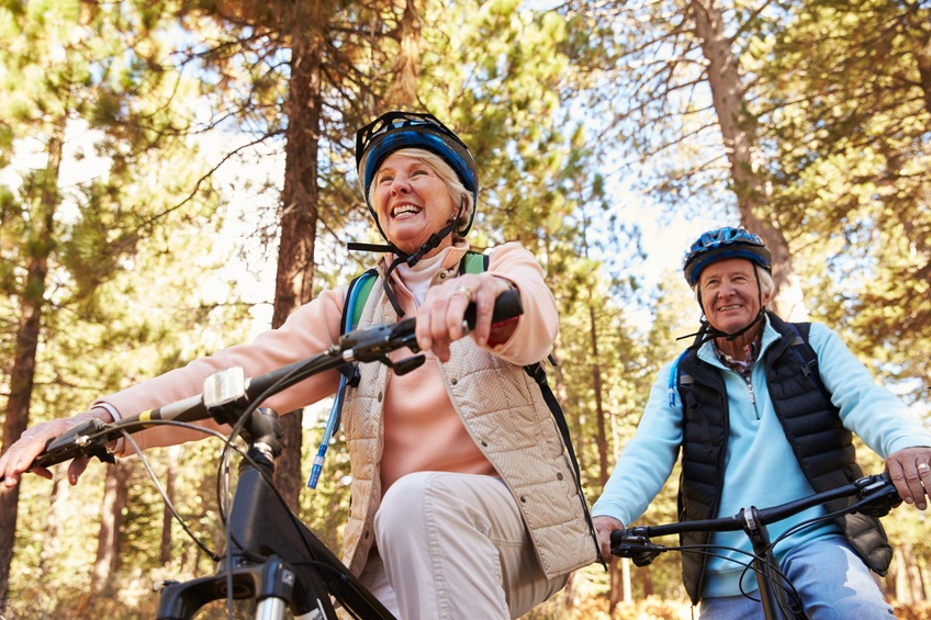 Senior couple mountain biking