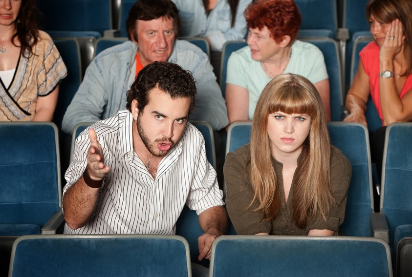 unhappy couple in a movie theater