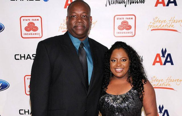 Lamar Sally and Sherri Shepherd pose for photos at a black tie event.
