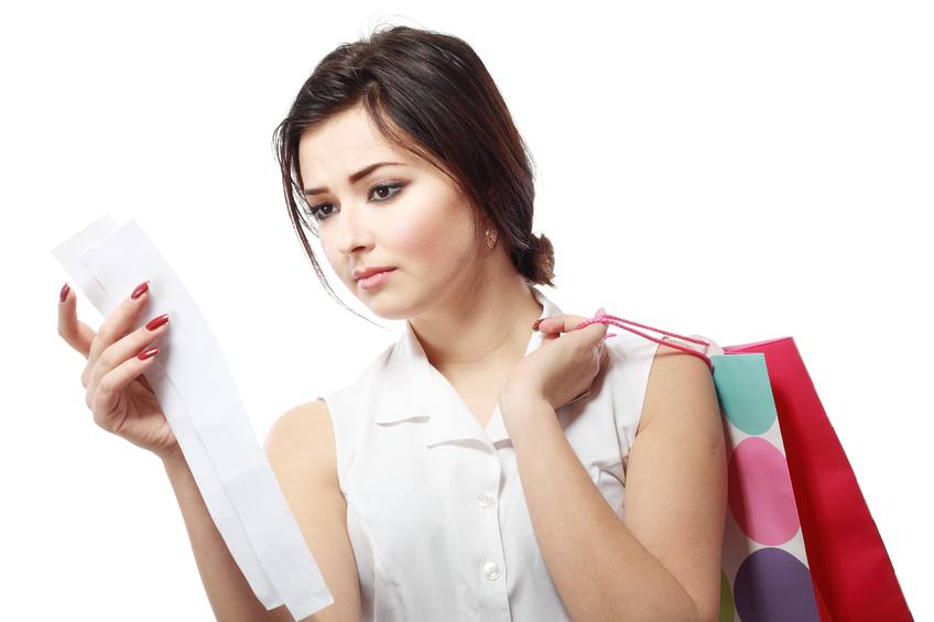 brunette woman looking at a receipt