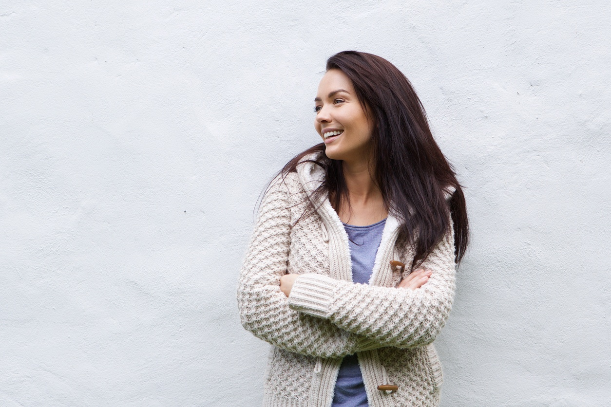 smiling woman in wool sweater