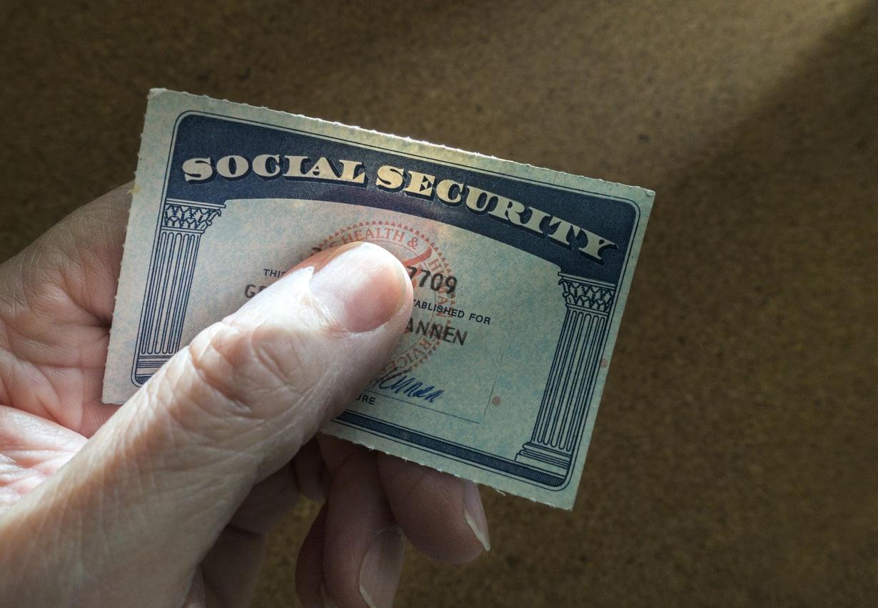 man holding Social Security card