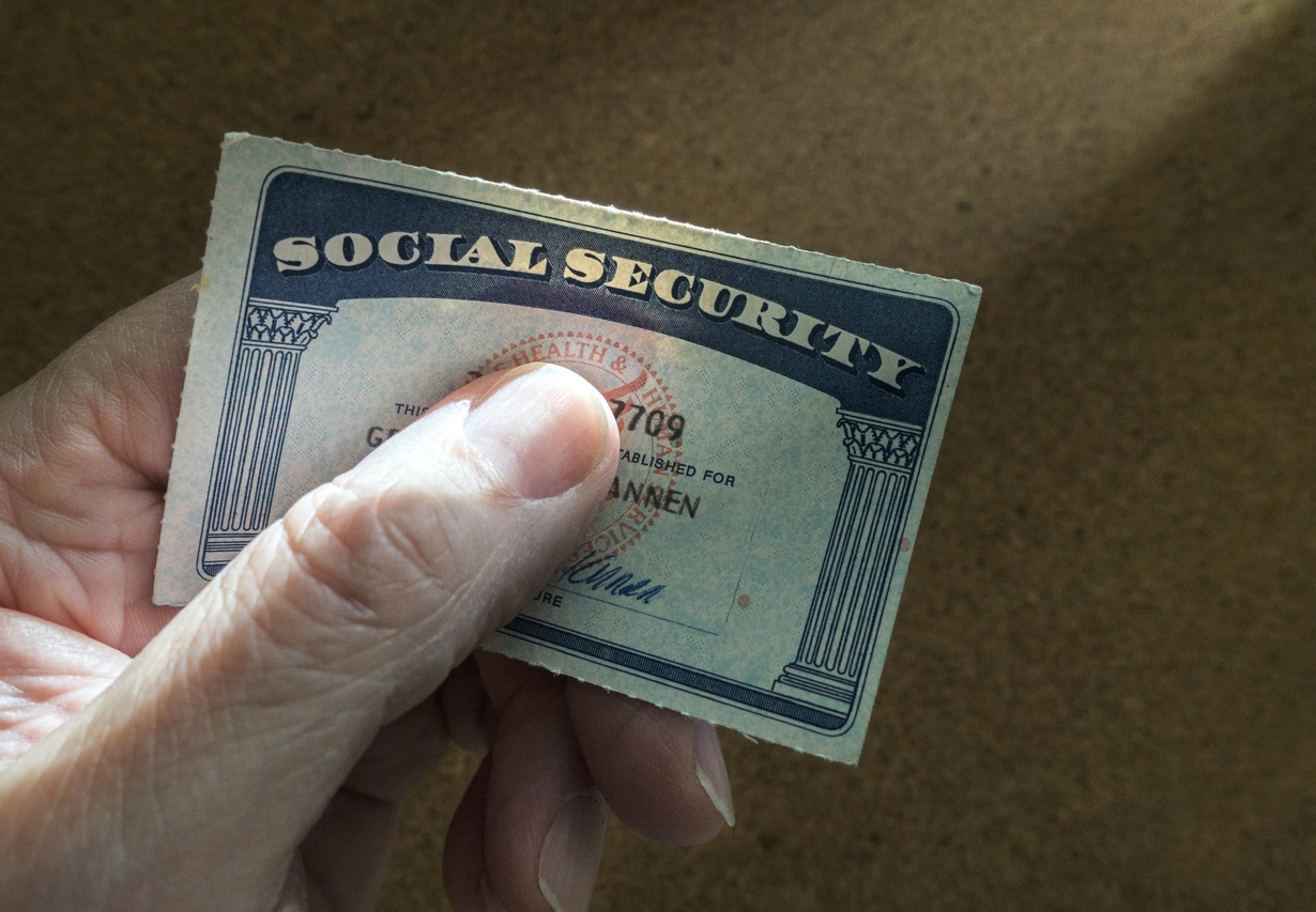 man holding social security card in his hand