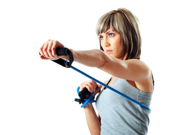 woman using resistance bands to make punching harder