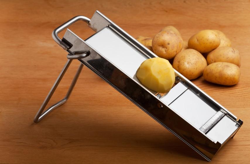 potato on a mandolin slicer
