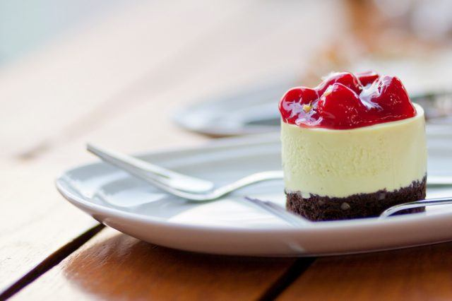 Strawberries cheesecake on the table.