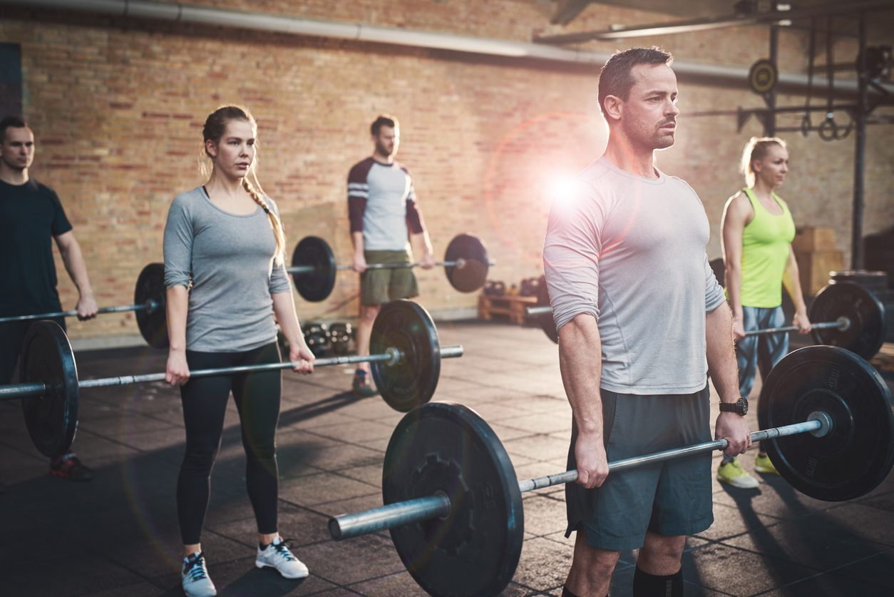 Athletes practice deadlifts