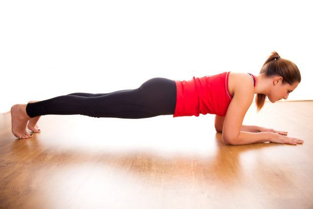 young woman doing plank