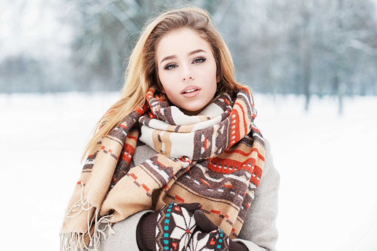 Girl in fashionable clothes with a scarf