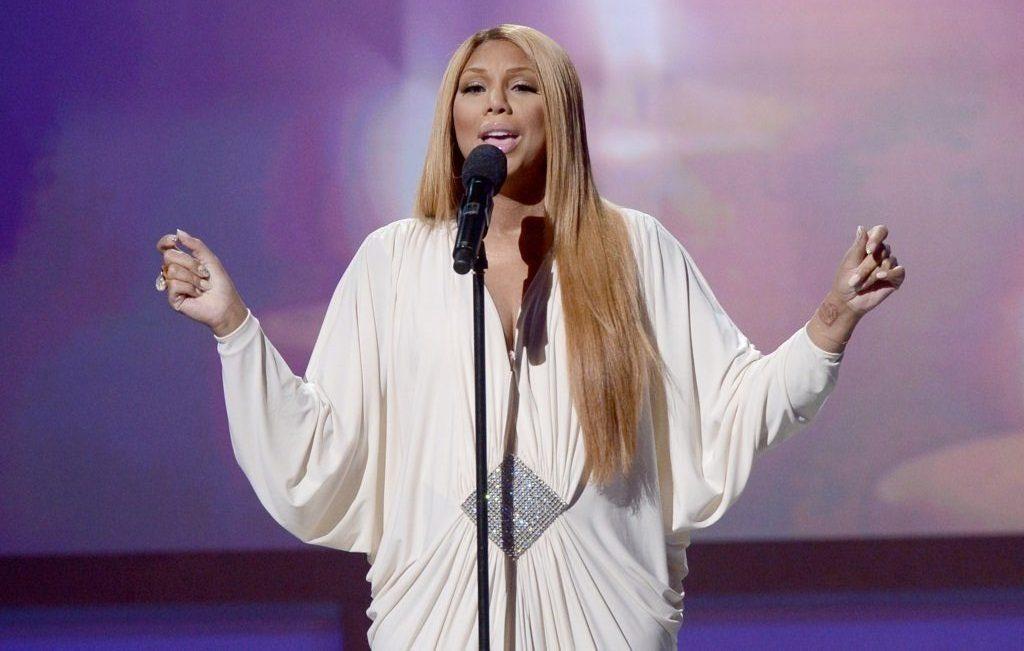 Singer Tamar Braxton performs onstage.